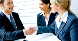 Successful people shaking hands making an agreement
