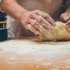 Closeup photo of baker making yeast dough for bread. Retro styled imagery